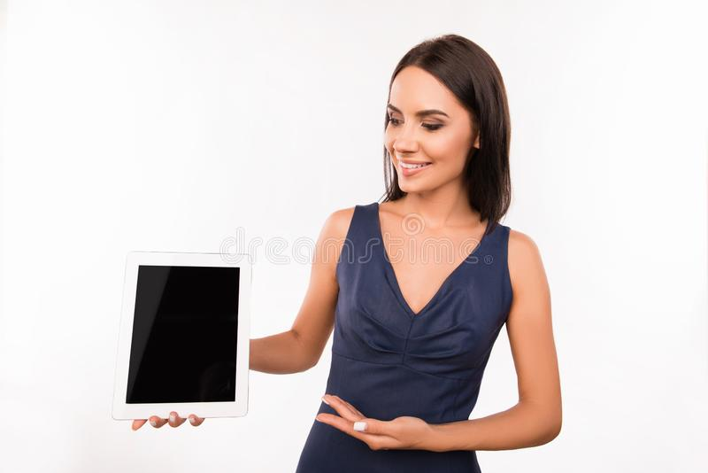 Successful pretty business woman demonstrating a tablet royalty free stock images