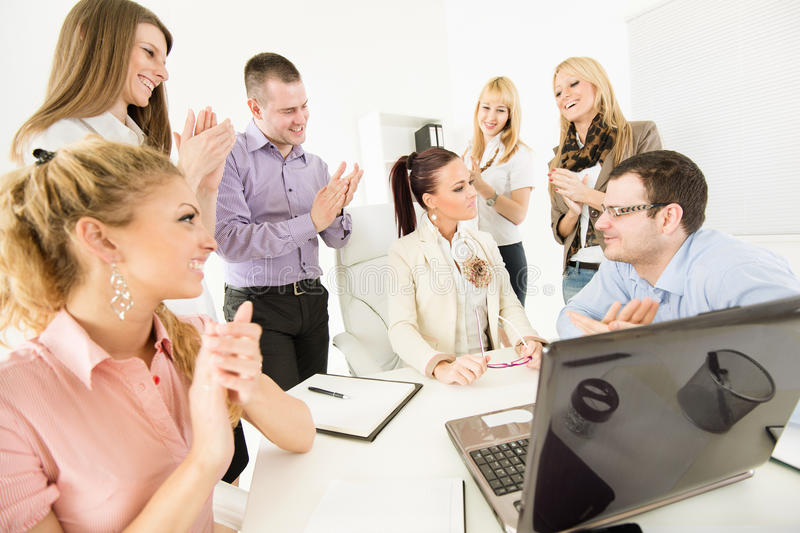 Successful project. Successful business team congratulates colleague on Successful Presentation with big applauding stock photography
