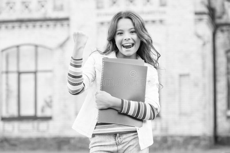 Successful pupil. Modern education. Kid smiling girl school student hold workbooks textbooks for studying. Education for stock images