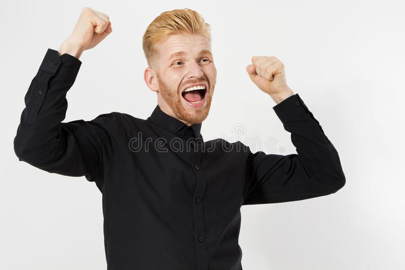 Successful red hair man celebrating with arms up - isolated over white stock photography