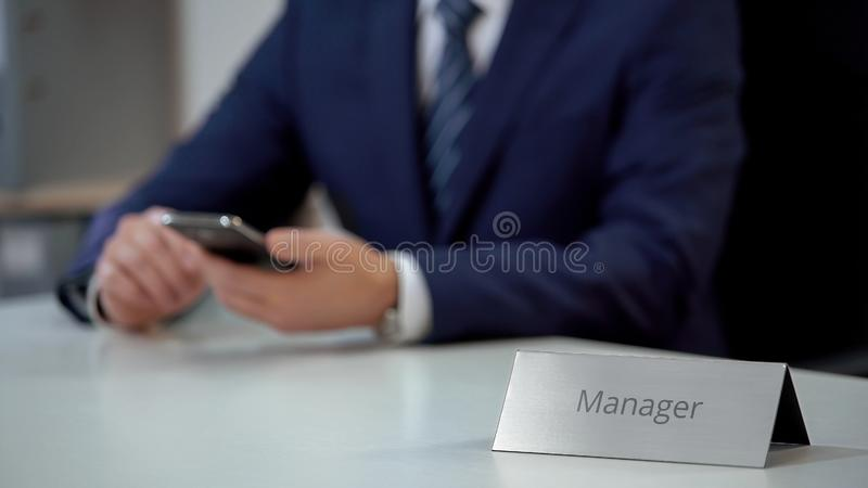 Successful sales manager chatting with client through smartphone, business deal royalty free stock photography