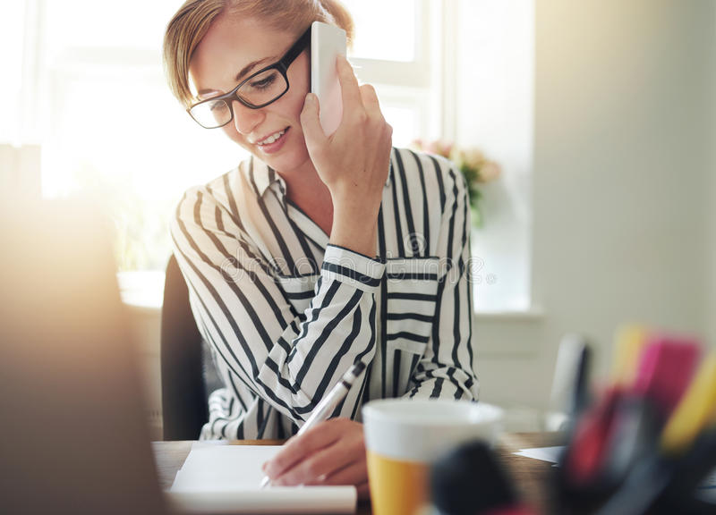 Successful self-employed young woman stock photography