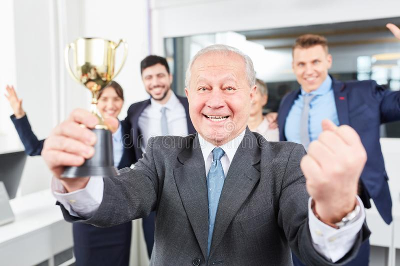 Successful senior entrepreneur with trophy royalty free stock image