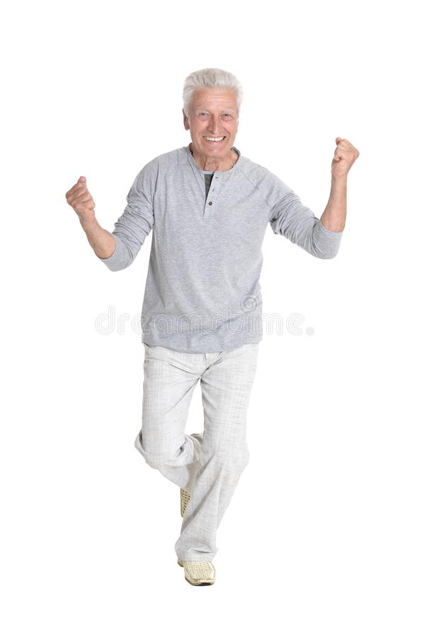 Successful senior man in casual clothing posing isolated stock photography