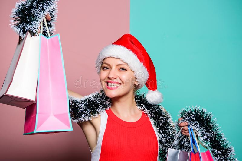 Successful shopping day. happy woman celebrate xmas. santa woman with tinsel. merry christmas shopping sales royalty free stock photography