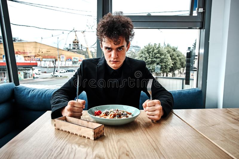 Successful small business owner having lunch in a luxury restaurant stock photography