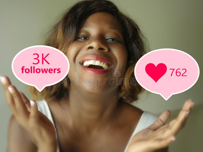 Young beautiful and happy black afro American woman celebrating excited one getting likes and followers on internet  app in royalty free stock photo