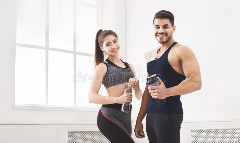 Successful sporty couple relaxing after hard training royalty free stock photography