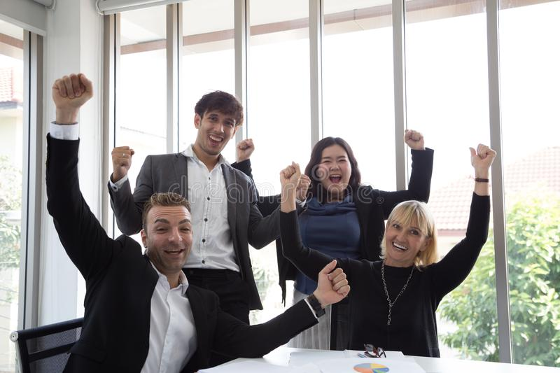 Successful startup entrepreneurs and business people team achieving goals celebrating giving high five in office. royalty free stock photos