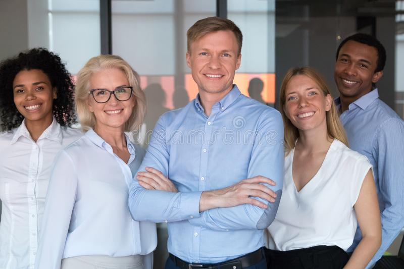 Successful startup founder company owner and staff members portrait concept. Smiling chief or professional business coach looking at camera posing in office royalty free stock photos