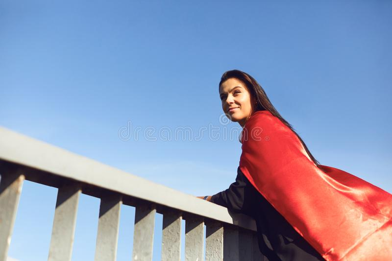Successful superhero businesswoman on a background of blue sky royalty free stock photography