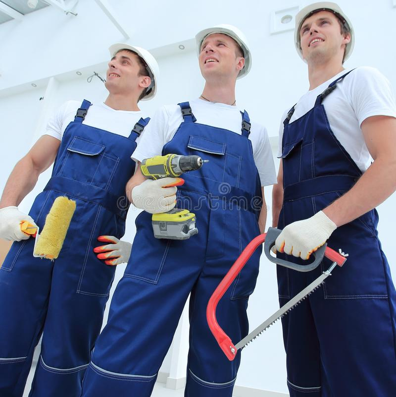Professional team of builders with tools stock photos