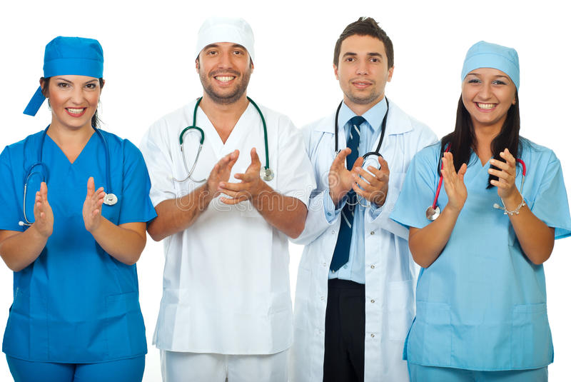 Successful team of doctors clapping together royalty free stock photo