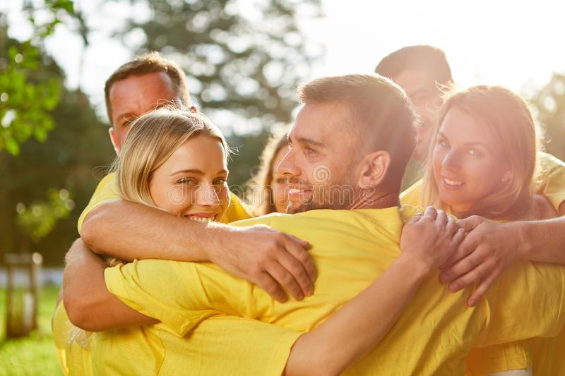 Successful team embraces each other happily stock image