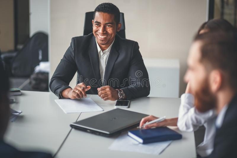 Team leader and business owner leading informal in-house business meeting royalty free stock photos