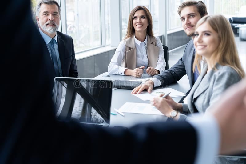 Successful team leader and business owner leading informal in-house business meeting royalty free stock image