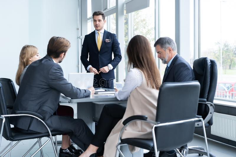 Successful team leader and business owner leading informal in-house business meeting royalty free stock photos
