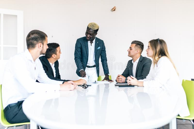 Successful team leader and business owner leading informal in-house business meeting. Business and entrepreneurship concept royalty free stock photo