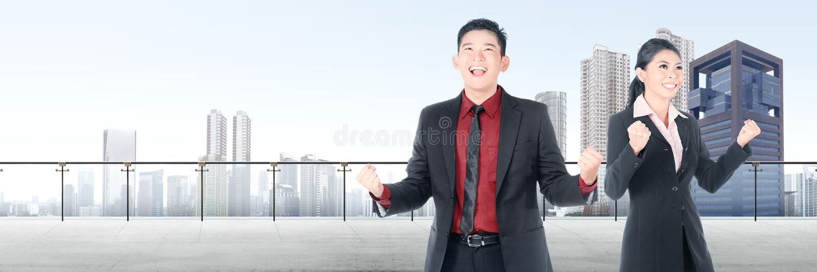 Successful two asian business people standing on modern terrace royalty free stock photo
