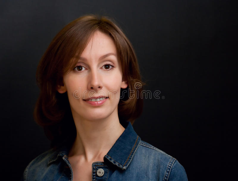 Successful woman. Portrait of an attractive beautiful pretty smiling young brown haired caucasian successful woman (lady, girl, female, person, model) with face royalty free stock photo