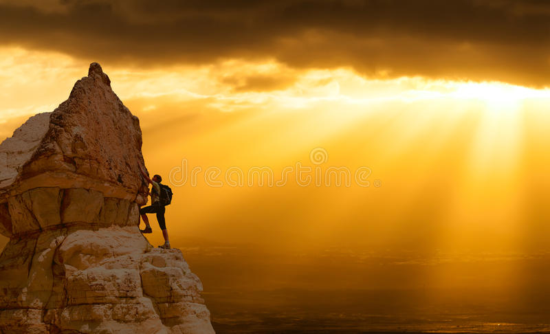 Successful woman Concept motivation, inspiration. Silhouette of successful climbing woman in mountains Concept of concept of motion motivation inspiration at