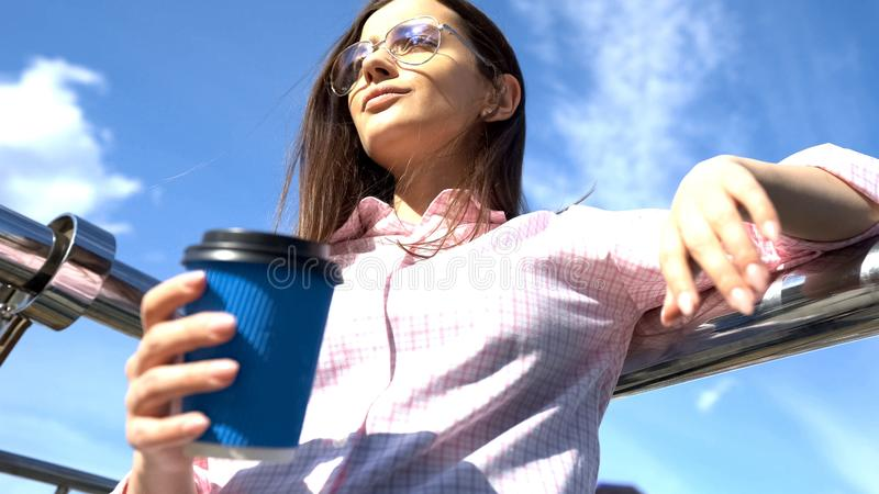 Successful woman drinking coffee on luxury yacht, smart and self-sufficient. Stock photo royalty free stock photos