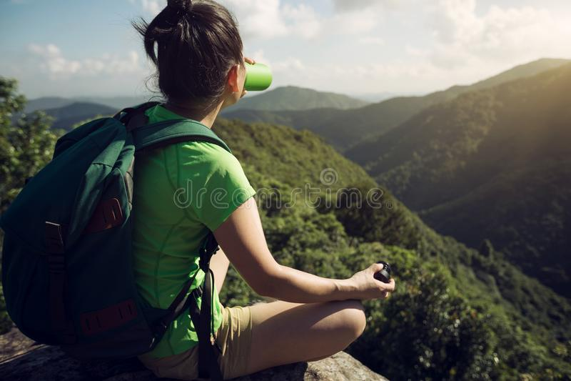 woman hiker drinking water on hiking travel stock image