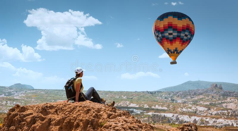 Successful woman and hot air balloon Concept motivation, inspiration royalty free stock image