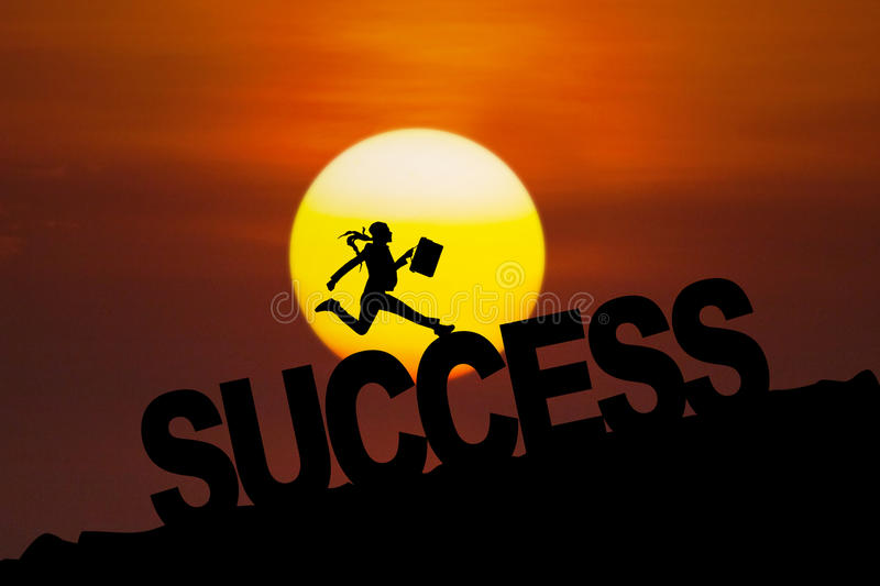 Successful woman jumping at sunset time royalty free stock images