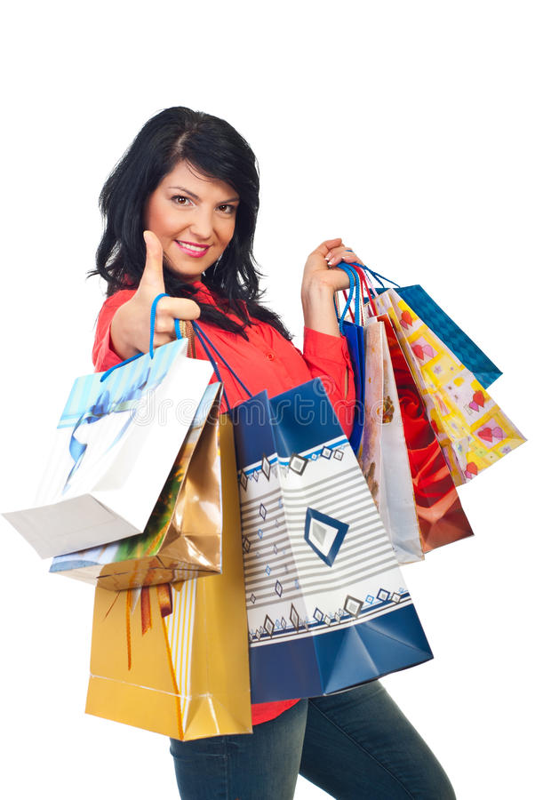 Successful woman at shopping give thumbs royalty free stock images