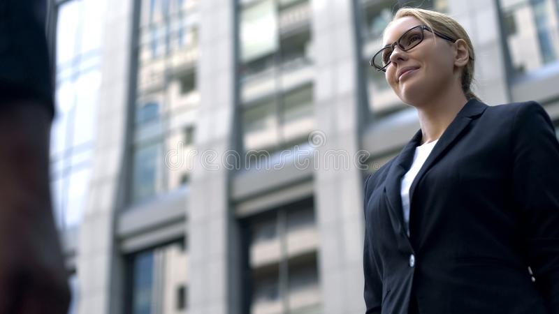 Successful woman standing against business center, female politician, statistics. Successful women standing against business center, female politician stock image