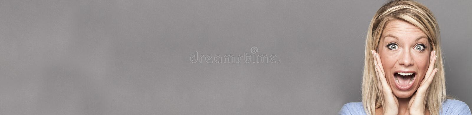 Successful woman using both hands for extrovert surprise and happiness,grey copy space long banner stock photography