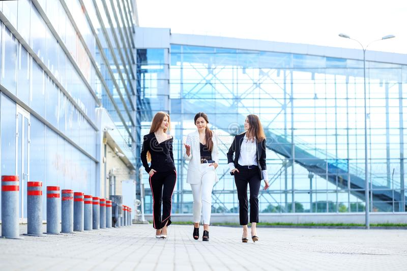Successful women go and discuss a new project. Concept for business, boss, robot, team and success stock images