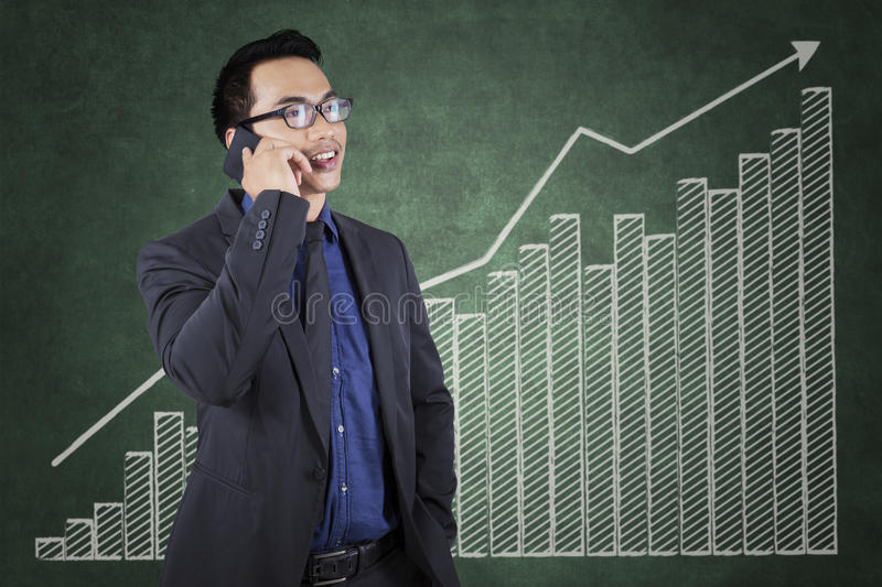 Successful worker with growing financial chart stock image