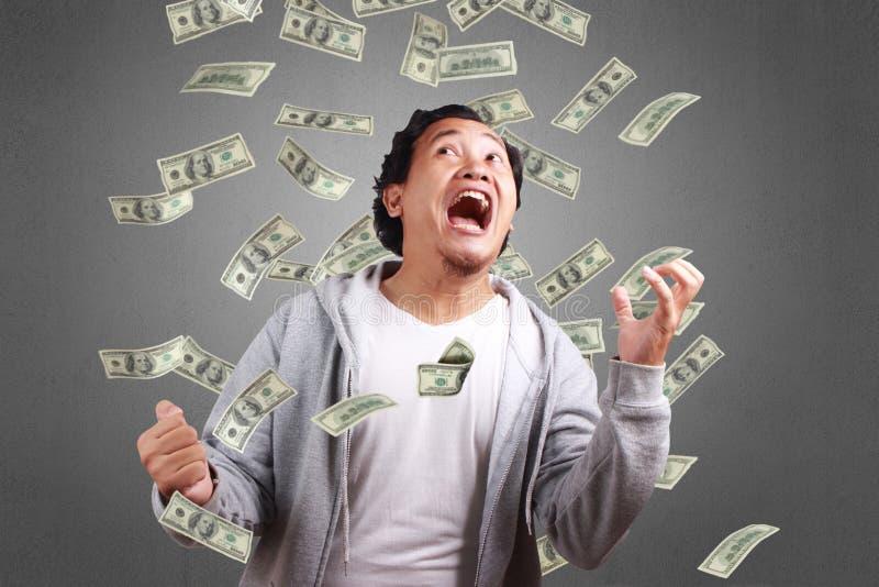 Successful Man In The Rain of Money stock photos