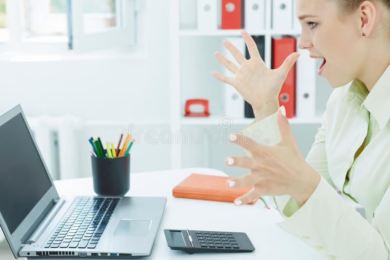 Successful young atractive woman looking on a laptop. stock photo