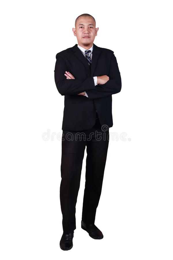 Successful young bald Asian businessman wearing suit smiling confidence looking at a camera, crossed arm, full body portrait stock image