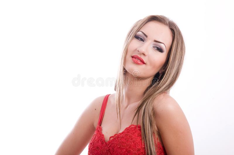 Successful young beautiful lady in a red dress stock image