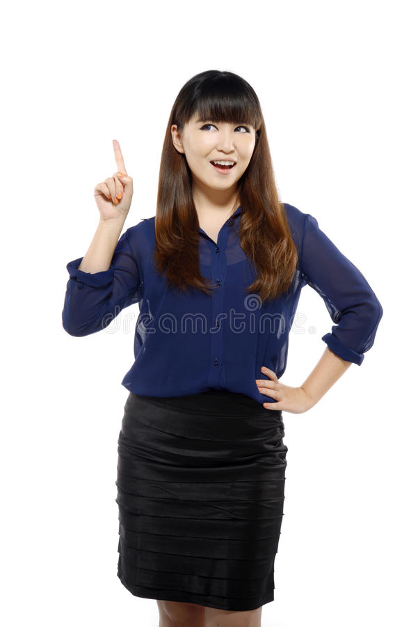 Successful young business asian woman pointing somewhere stock photography