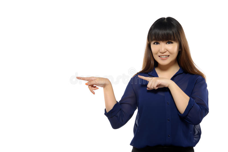 Successful young business asian woman pointing somewhere royalty free stock image
