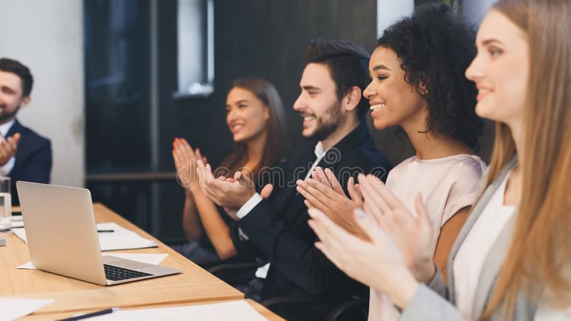 Successful young business group applauding after presentation royalty free stock image