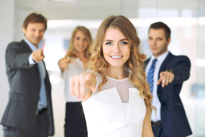 Successful young business people pointing by fingers into camera royalty free stock images