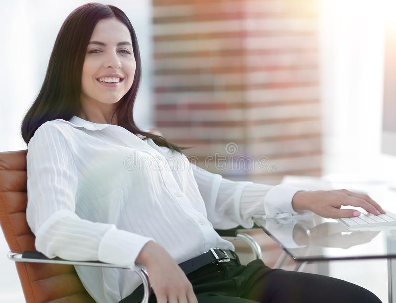 Successful young business woman sitting at workplace. Portrait of successful young business woman sitting at workplace in office. photo with copy space stock images