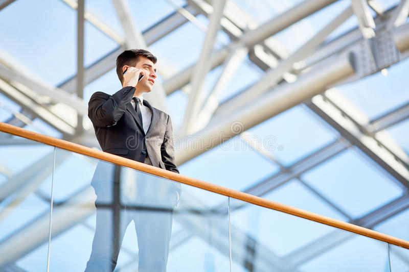 Successful Young Businessman Speaking by Phone stock image