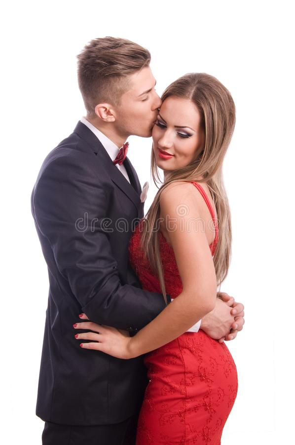Successful young elegant couple kissing royalty free stock image