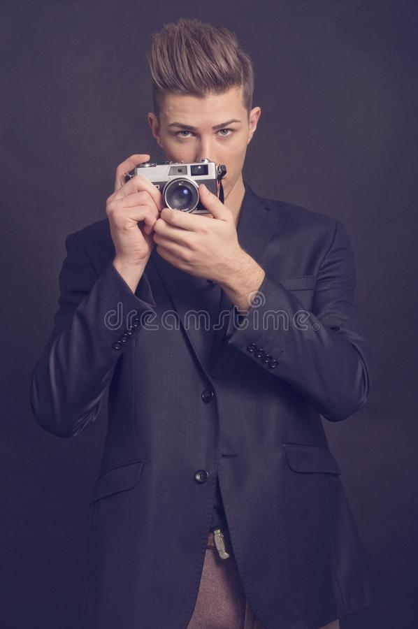 Successful young man on black background royalty free stock photo