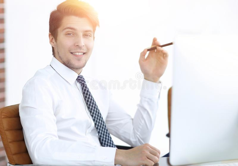 Employee,sitting in front of the laptop. Successful young employee,sitting in front of the laptop .photo with copy space stock photo