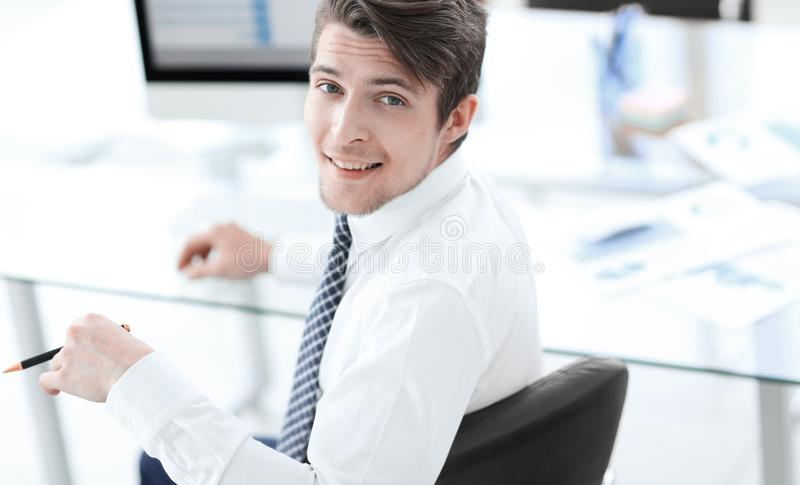 Employee,sitting in front of the laptop. Successful young employee,sitting in front of the laptop .photo with copy space royalty free stock photos