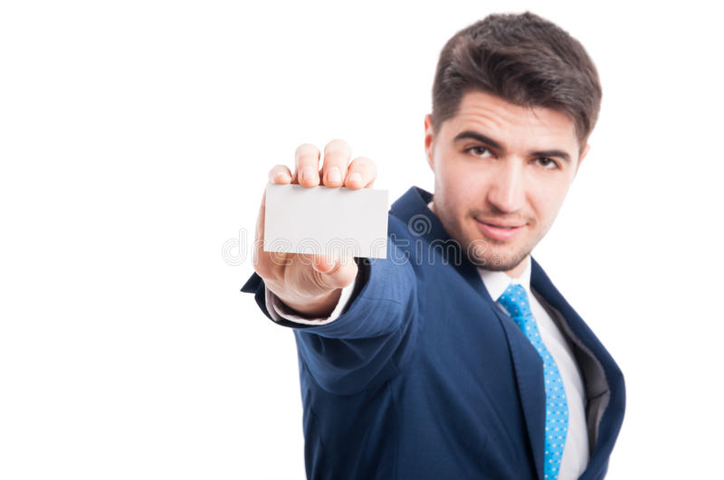 Successful young entrepreneur holding blank business card. Successful young entrepreneur holding blank business or visit card with advertising area isolated on stock photo