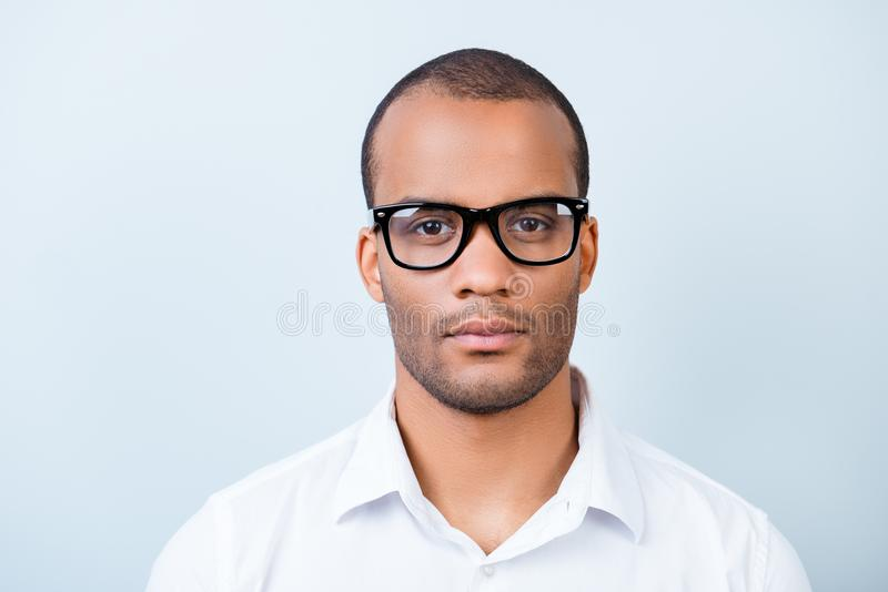 Successful young handsome mulatto american guy banker in formal stock photography